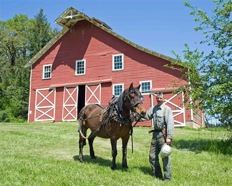 Cowboys Barn file cowboy with in front of barn house jpg