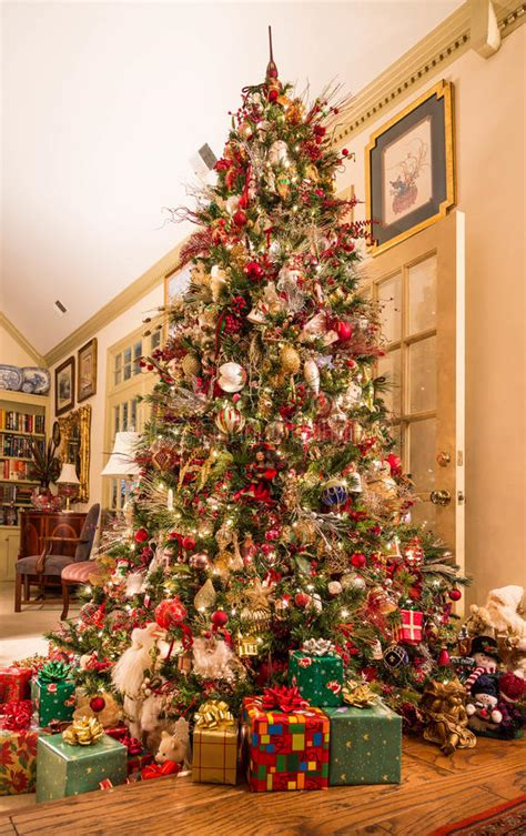photo of the most beautifully decorated christmas tree presents decorated tree in den stock photo image of celebration presents