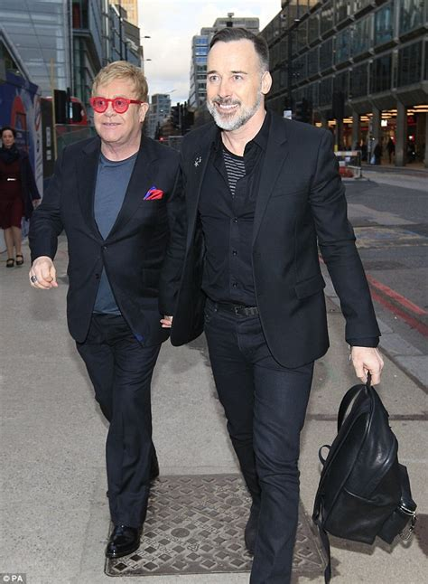elton john and husband elton john and david furnish enjoy closing show of billy
