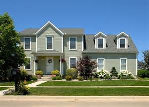 Sunroom Designs Of Nebraska Green Colored Home With Grey Shingles America S