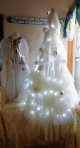 The wedding dress tree goes so perfectly with my angel dress love