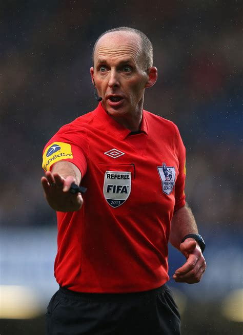 mike dean in chelsea v wigan athletic premier league