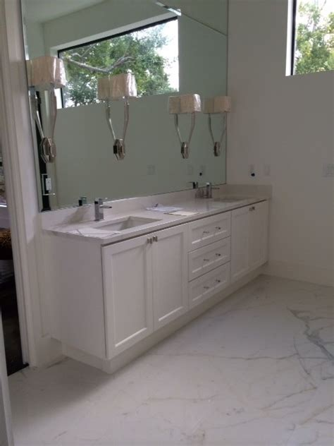 Porcelain Countertops Bathroom calacatta porcelain slab vanity tops and side splashes dallas by casalinea
