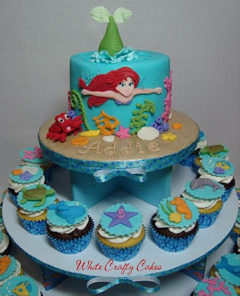 the mermaid cake and cupcake tower up of fondant cupcake toppers cake