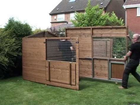 puppy has the runs timberbuild kennel and run being assembled