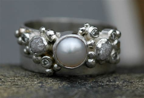 melee and pearl engagement ring and