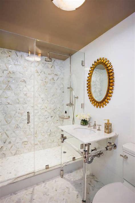 black washstand with gold sunburst mirror transitional
