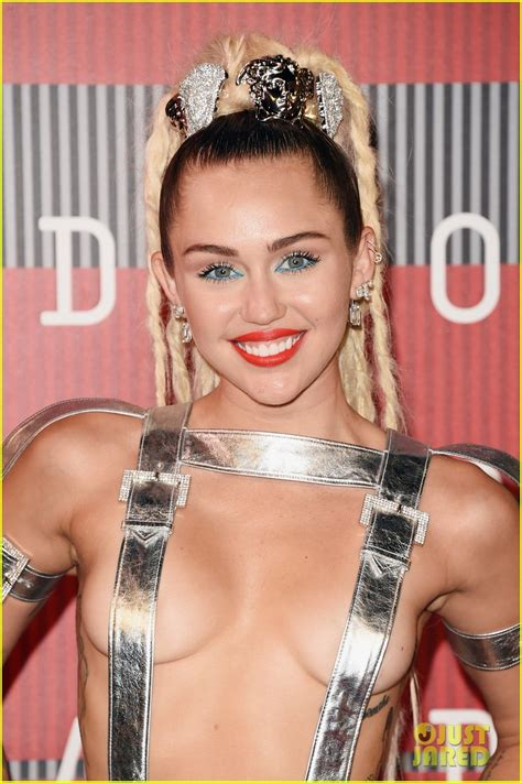 does miley cirus wear contacts miley cyrus wears almost nothing on mtv vmas 2015 red