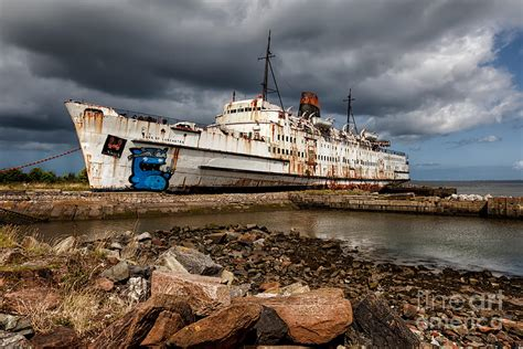 boat salvage company near me abandoned ship photograph by adrian evans