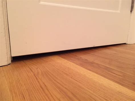 how to fill gap between cabinet and floor door sweep uneven floor w variable gap between opened and