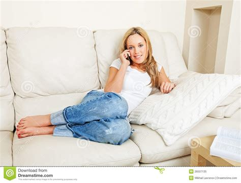 phone couch young woman on sofa with phone royalty free stock photo