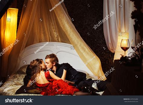 kissing in the bedroom beautiful couple is kissing in the bedroom stock photo