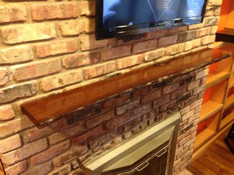 hand crafted  edge slab fireplace mantel  mad
