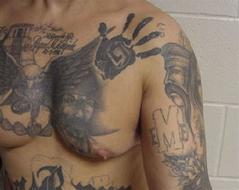mexican mafia la eme tattoos on the chest and arm gang
