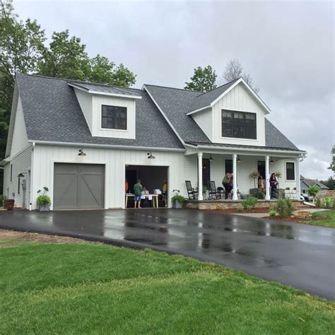white ranch house with black garage door wisconsin parade home is open mathis interiors