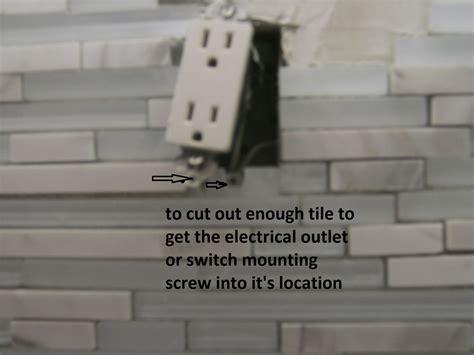 how to cut glass tile backsplash around outlets home tile around outlet tile design ideas