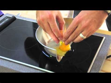 induction cooking eggs to demonstrate how induction cooking works a chef cooks eggs bacon and chocolate on a pan cut in