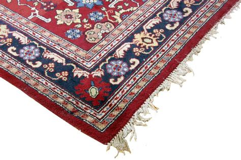 large burgundy rug large wool rug burgundy blue gold with fringe border in overall condition 13 ft lo