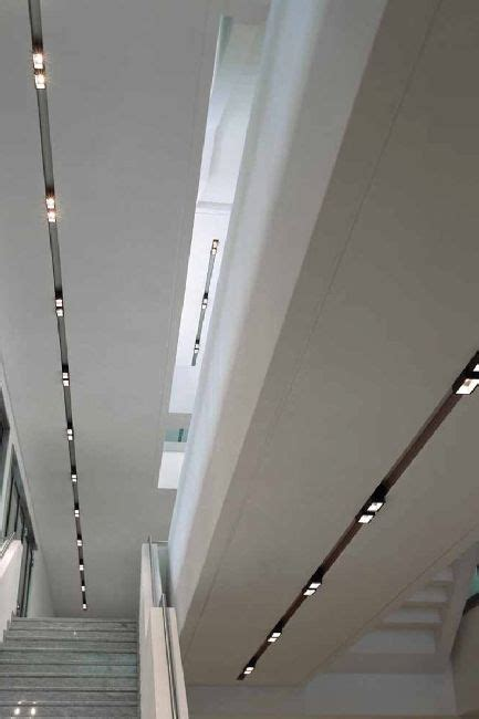 Track Lighting Suspended Ceiling Clean And Minimalist White Ceiling With Integrated Lighting Office Lighting