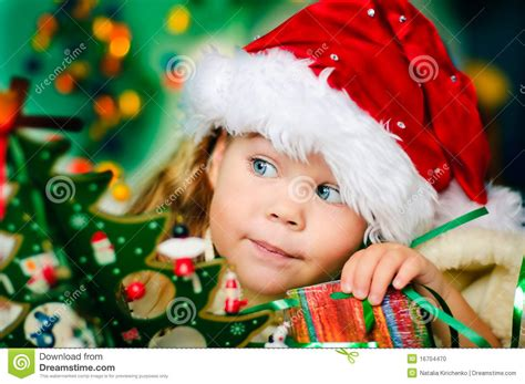 happy small girl  santas hat   christmas stock photo image