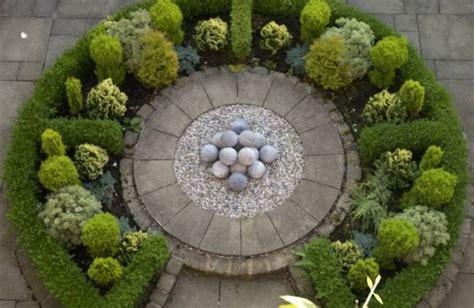 the artful gardener circular formal garden design