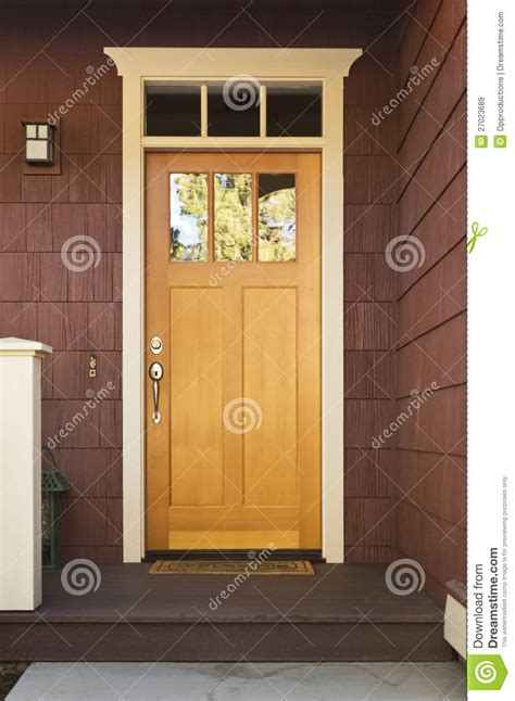 Light Wood Front Door On A Home Stock Image Image 27023689 Front Door Light Timer
