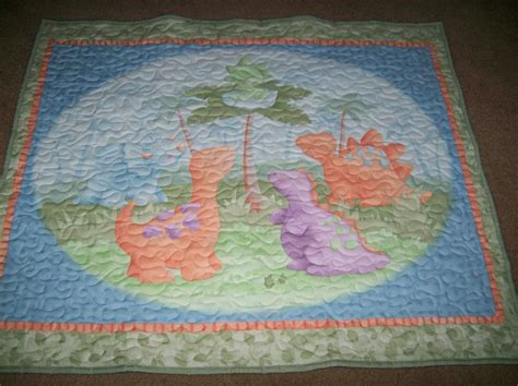 Dinosaur Baby Quilt dinosaur baby quilt in pastel colors by carolsquiltsetc on