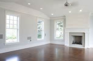 light gray walls with white trim dark wood floors home
