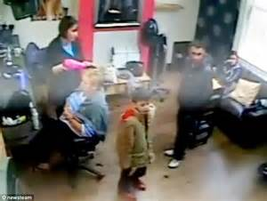 boys taken to beauty salon child caught on camera stealing mobile phone from