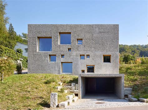 Modern Concrete House Puntured With Square Windows   DigsDigs
