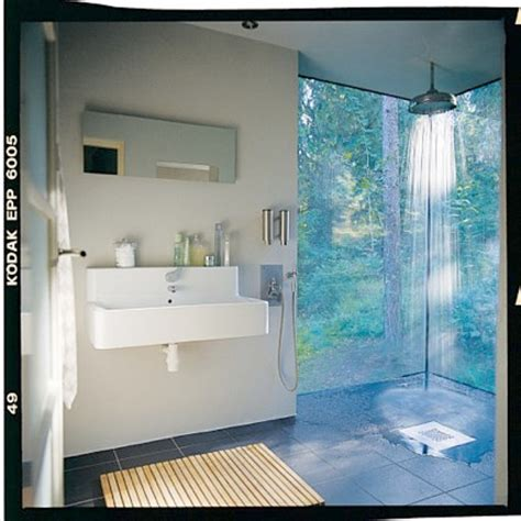 defined by two walls of glass the shower in this swedish bathroom captures the feel of bathing