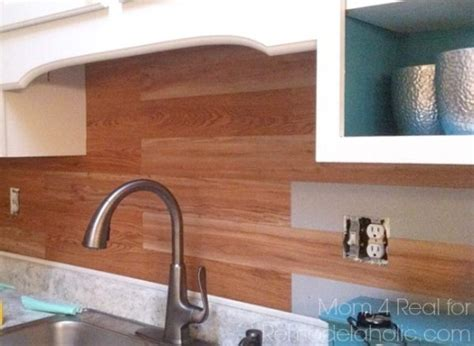 vinyl tile backsplash remodelaholic diy plank backsplash using peel and stick