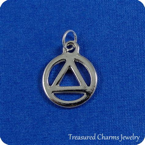 aa recovery charm silver plated recovery symbol charm for