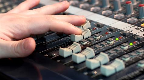 Audio Mixer Belt Up fingers move the fader sliders sound mixer up mixing desks audio production consoles