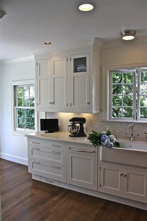 creamy white kitchen cabinets toe kick drawer transitional kitchen william adams