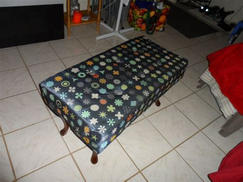 make an ottoman from a coffee table repurpose an old coffee table to make an ottoman
