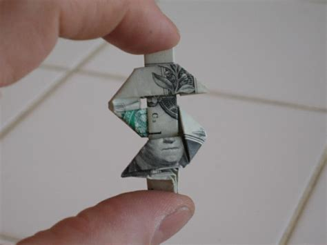 Origami Dollar Sign - origami by andrew anselmo repertoire