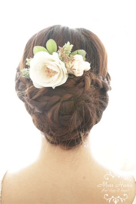 vintage wedding flowers in hair bridal hair accessory white camellia winter pine