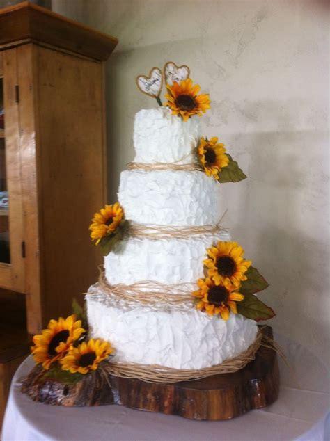 Sunflower wedding cake with wood base   Cake ideas