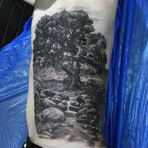 tattoo of us streaming gray washed style side tattoo of countryside tree and