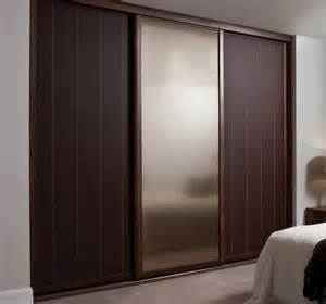 Home Decor Sliding Wardrobe Doors by Dark Wood Sliding Wardrobe Doors Design Inspiration