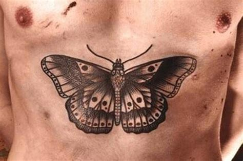 harry styles oddly large butterfly chest tattoo