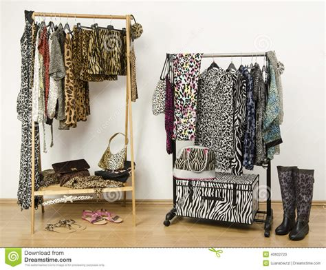 jungle pattern clothes dressing closet with animal print clothes arranged on