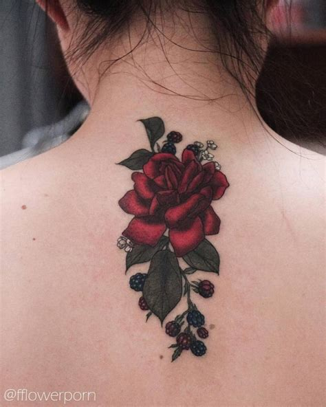 red parlour tattoo and blackberries on the back