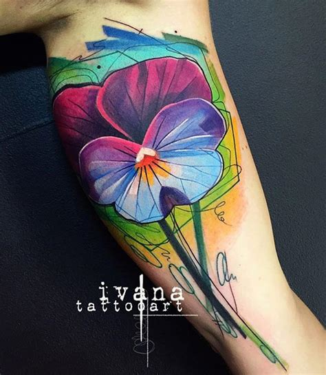 bright amp colorful flower on bicep best tattoo ideas