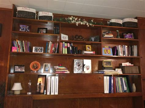 modern arrangement of books and knick knacks in an