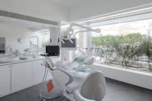 Contemporary dental clinic design by paulo merlini wooden interior