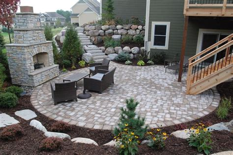 walkout basement backyard ideas retaining wall stairs leading to patio below by walkout