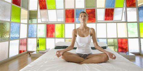 yoga in bed yoga poses you can do without leaving your bed huffpost