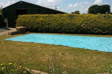 build   swimming pool  bales  hay home